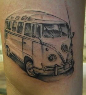 Black cute car tattoo on leg