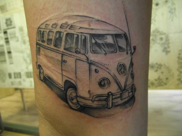 Black cute car tattoo on leg