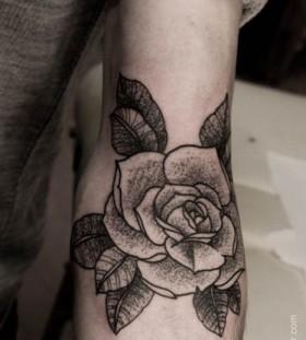 Black cute rose tattoo on arm