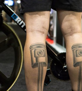 Black design of bicycle tattoo on leg