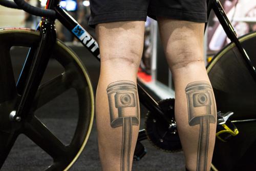 Black design of bicycle tattoo on leg