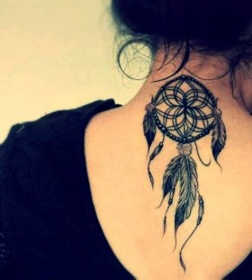 Black dream catcher tattoo on back