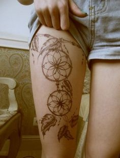 Black dream catcher tattoo on leg