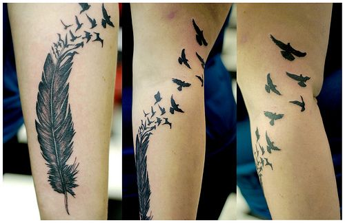 Black feather and bird tattoo on leg