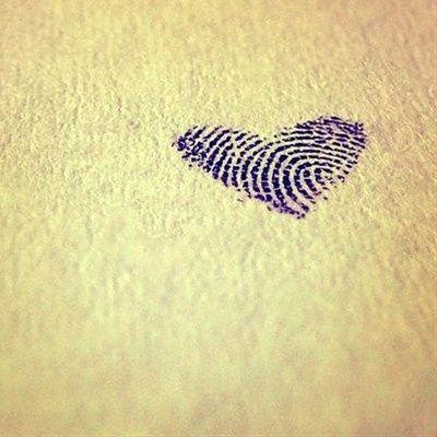 Black fingers heart tattoo