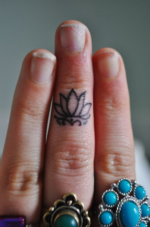 Black fingers ornaments tattoo
