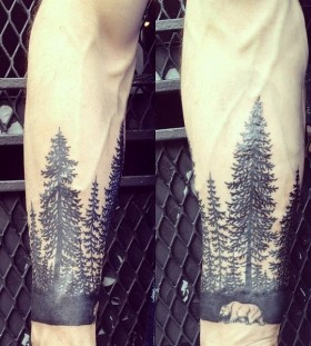 Black forests and bear tattoo on leg