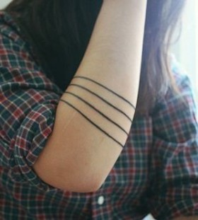 Black funny line tattoo on arm