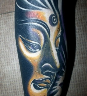 Black girl face tattoo on leg