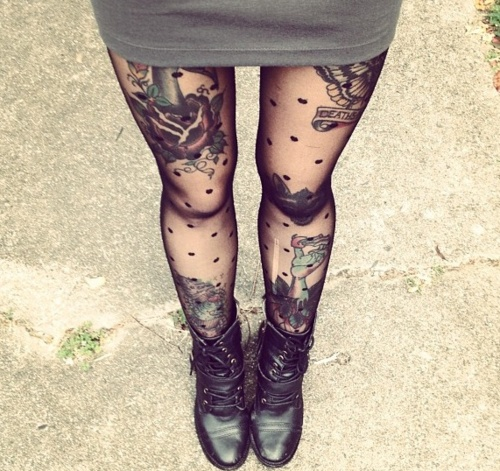 Black girl's lace tattoo on leg