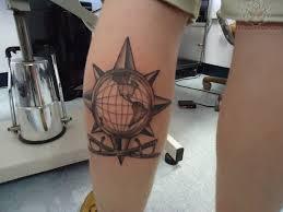 Black globe tattoo