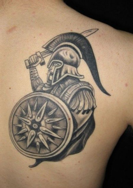 Black greek soldier tattoo on arm
