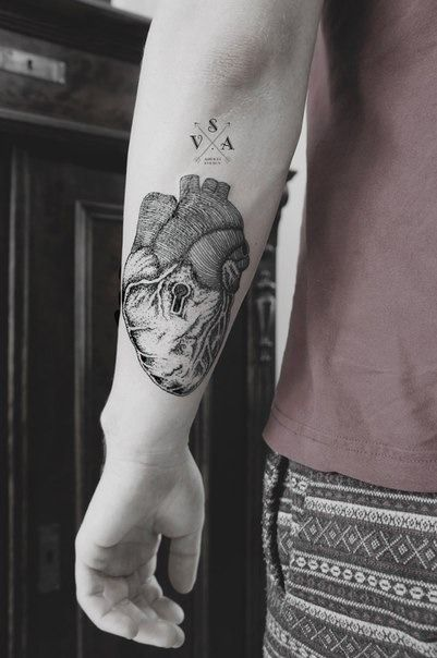 Black heart and keyhole tattoo