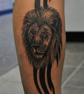 Black lines and lion tattoo on leg