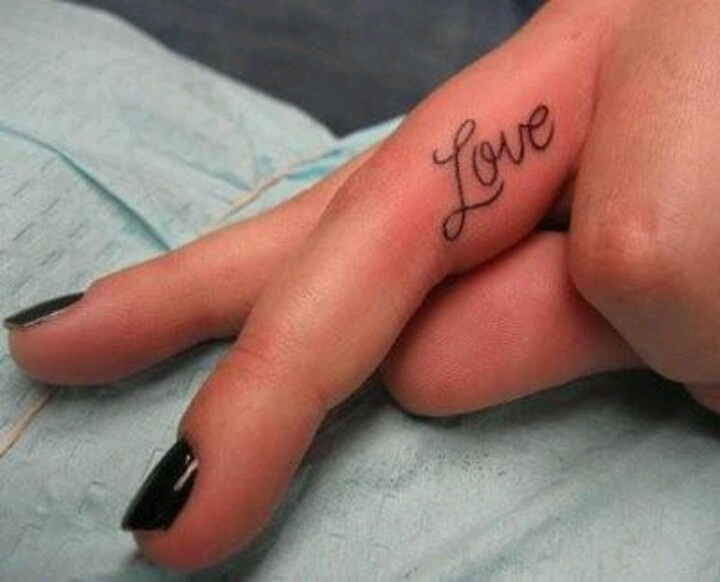 Black love quote tattoo on finger