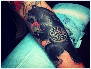Black lovely bear tattoo on arm