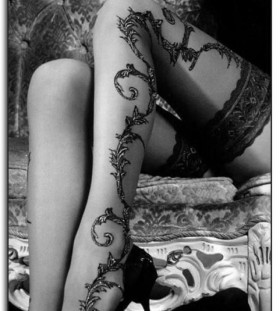 Black lovely lace tattoo on leg