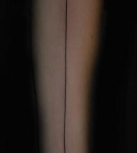 Black lovely line tattoo on arm