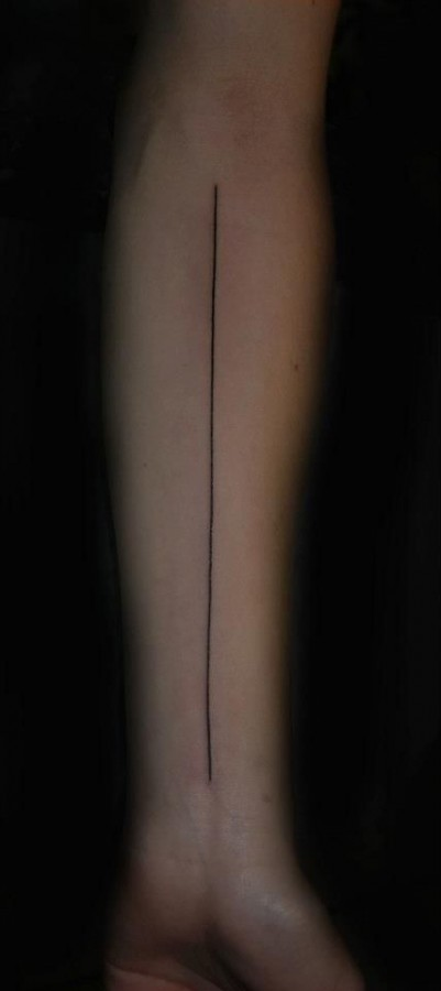 Black lovely line tattoo on arm