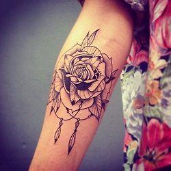 Black lovely rose tattoo on arm