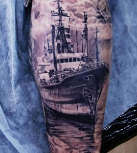 Black lovely ship tattoo on arm