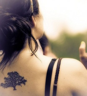 Black lovely tree tattoo on shoulder