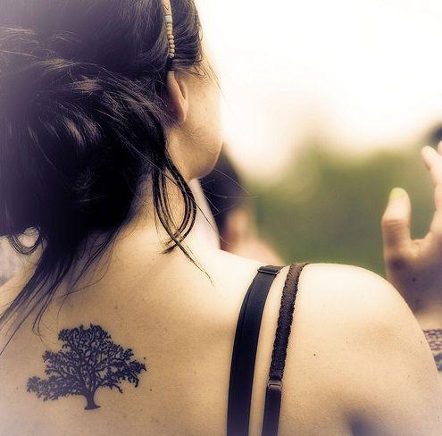 Black lovely tree tattoo on shoulder