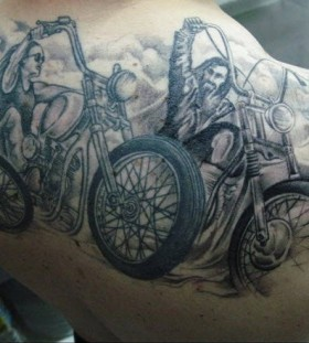 Black men's bicycle tattoo on back