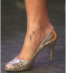 Black music style tattoo with shoes