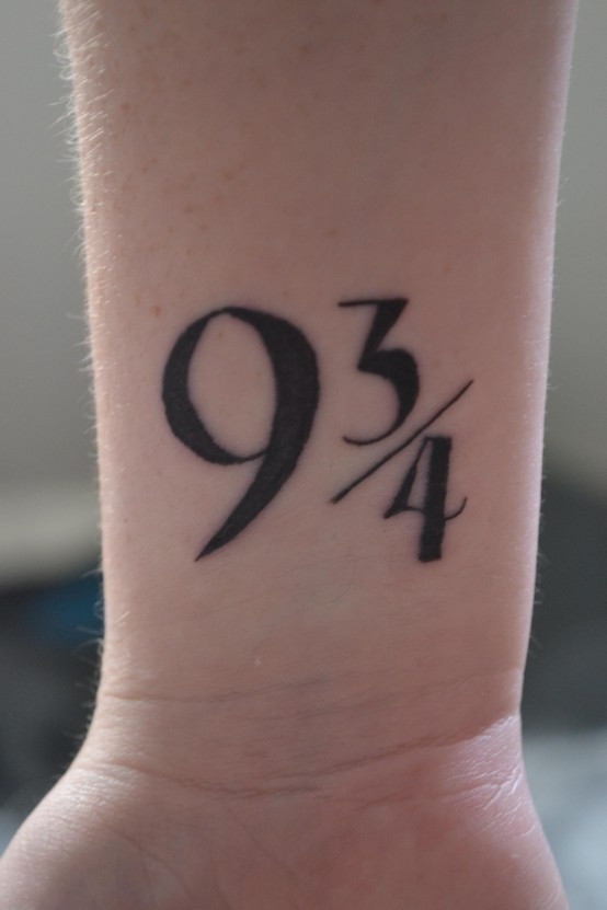 Black numbers ornaments tattoo