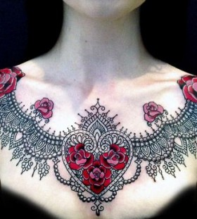 Black ornaments and red heart flower tattoo on chest