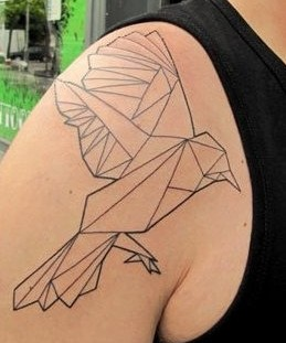 Black ornaments of origami tattoo on shoulder