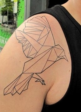 Black ornaments of origami tattoo on shoulder