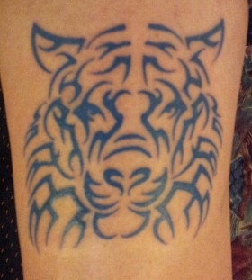 Black ornaments of tiger tattoo on leg