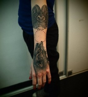 Black owl and amazing wolf tattoo on arm