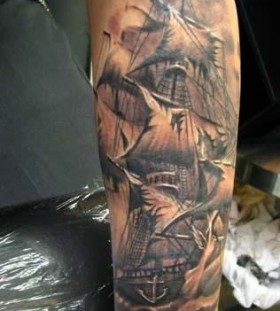 Black pirates ship tattoo on arm