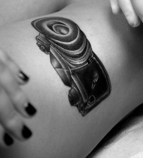 Black pretty camera tattoo on leg