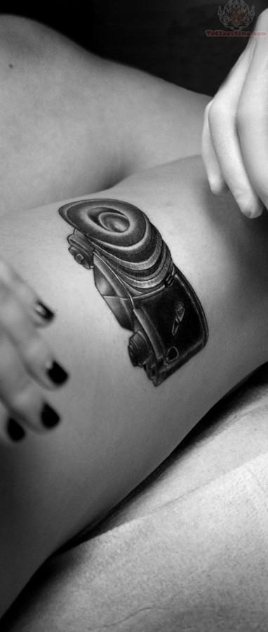Black pretty camera tattoo on leg