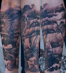 Black pretty ship tattoo on arm