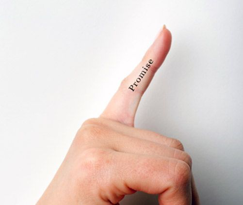 Black promise quote tattoo on finger