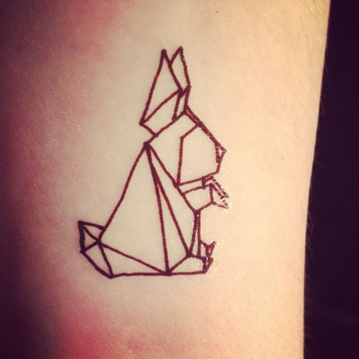 Black rabbit origami tattoo on arm