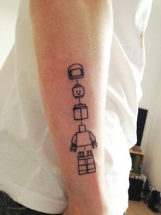 Black robbots line tattoo on leg