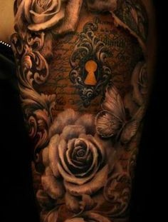 Black roses and keyhole tattoo