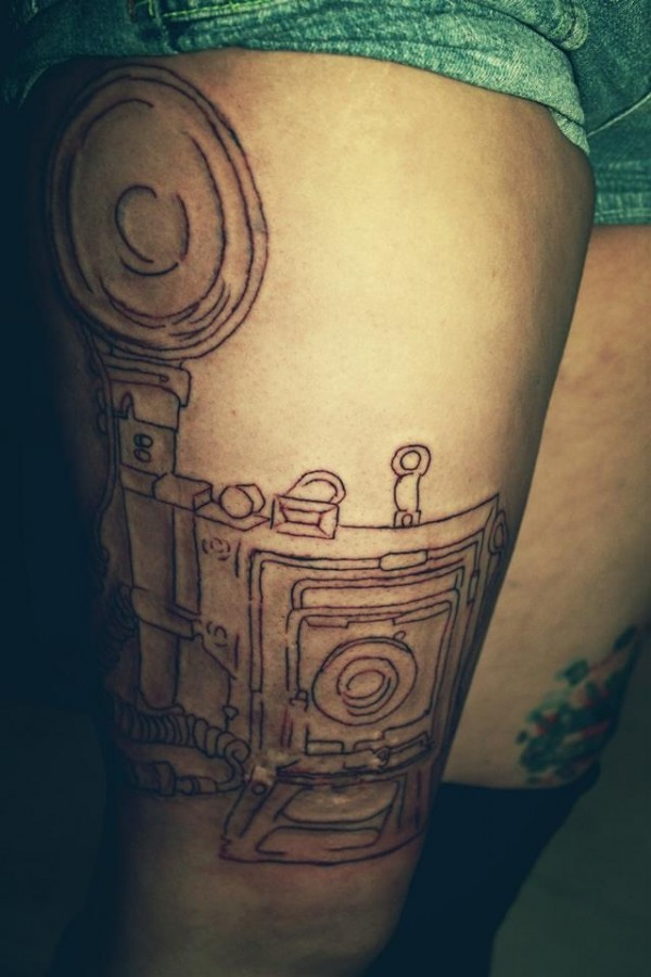 Black schemes of camera tattoo on arm