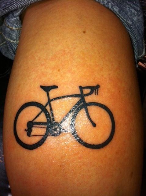 Black simple bicycle tattoo on leg