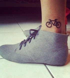 Black simple bike tattoo with shoes