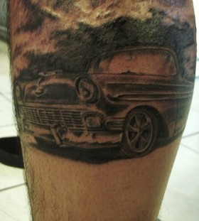 Black simple car tattoo on leg