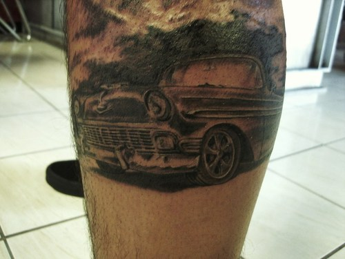 Black simple car tattoo on leg