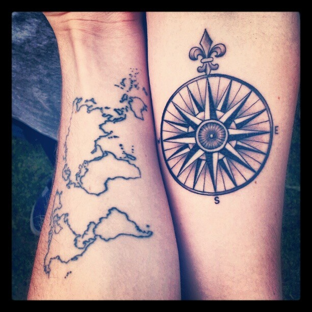 Black simple compass and map tattoo on arm