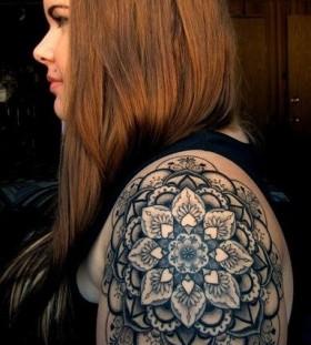 Black simple flower tattoo on hand